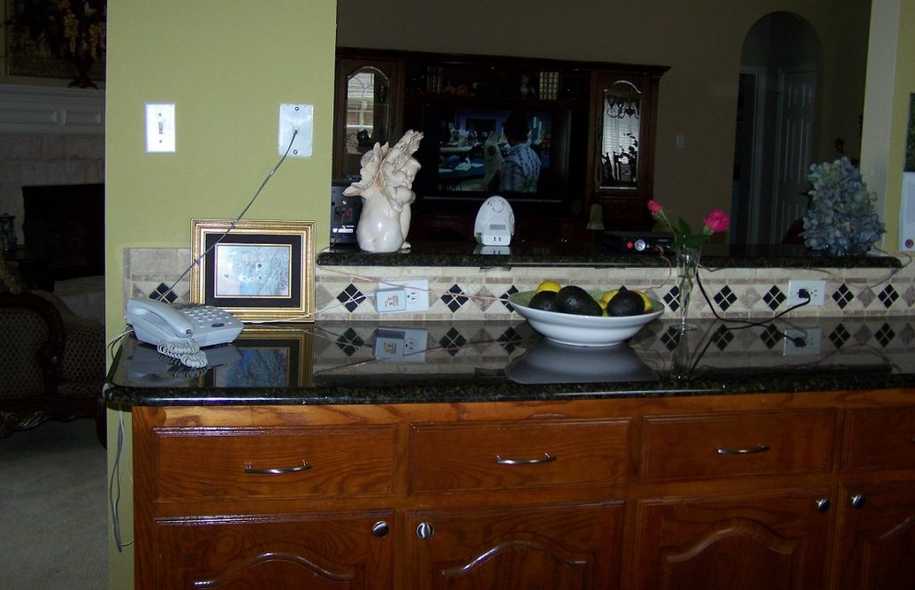 Before: cathedral-style varnished cabinets